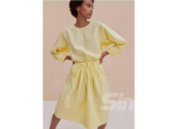 GAUN warna kuning lembut menyuntik sisi feminin dan romantis si pemakai.