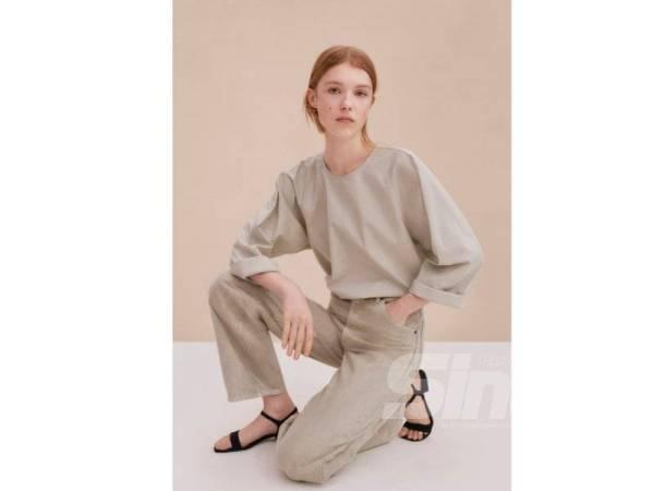 HIMPUNAN Uniqlo U ideal digayakan wanita yang gemarkan konsep santai dan ringkas.