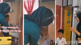 [VIDEO] Cikgu dipuji tak kekok lap hingus anak murid pada hari pertama sekolah dibuka